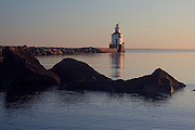 WI00177-00...WISCONSIN - Sunrise at Wisconsin Point Lighthouse on Lake Superior near the town of Superior.