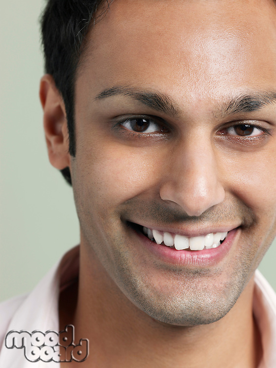 Mid adult man smiling close-up