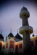 An evening view of the central mosque in Pattani. Thailand is struggling to keep up appearances as the land of smiles has to face up to its troubled south. Since 2004 more than 3500 people have been killed and 4000 wounded in a war we never hear about. In the early hours of January 4th 2004 more than 50 armed men stormed a army weapons depot in Narathiwat taking assault rifles, machine guns, rocket launchers, pistols, rocket-propelled grenades and other ammunition. Arsonists simultaneously attacked 20 schools and three police posts elsewhere in Narathiwat. The raid marked the start of the deadliest period of armed conflict in the century-long insurgency. Despite some 30,000 Thai troops being deployed in the region, the shootings, grenade attacks and car bombings happen almost daily, with 90 per cent of those killed being civilians. 19.09.07. Photo: Christopher Olssøn