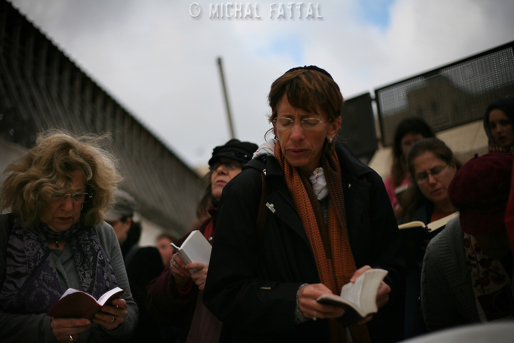 Jewish women of the Women of the Wall organization pray at the Western Wall,  Judiasm's holiest site in Jerusalem's Old City. Women of the Wall is a group of mostly religiously observant women who believe that women should be allowed to pray as a group at the Western Wall read from a Torah scroll and wear prayer shawls and phylacteries that in orthodox Judaism are used only by men...