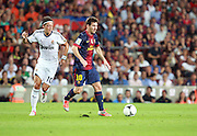 Lionel Messi attacks for Barcelona taking on Mesmut Ozil of Madrid.  Barcelona v Real Madrid, Supercopa first leg, Camp Nou, Barcelona, 23rd August 2012...Credit - Eoin Mundow/Cleva Media.