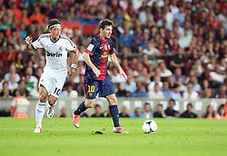 Lionel Messi attacks for Barcelona taking on Mesmut Ozil of Madrid.  Barcelona v Real Madrid, Supercopa first leg, Camp Nou, Barcelona, 23rd August 2012...Credit - Eoin Mundow/Cleva Media.
