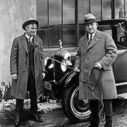Studebaker President Albert Erskine (R) and humorist Will Rogers in front of a 1927 Studebaker.
