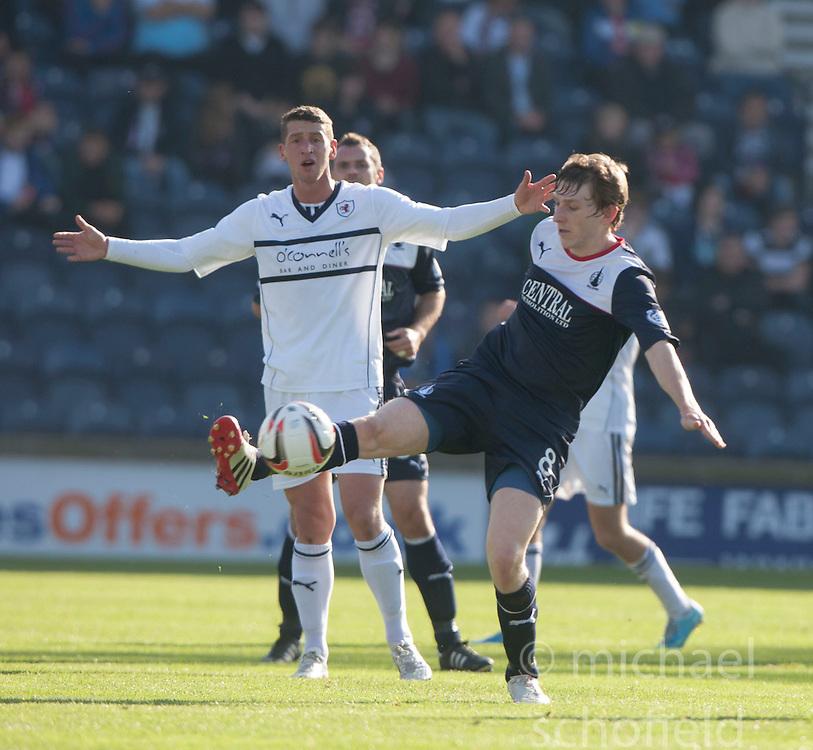 Raith Rovers Calum Elliot and Falkirk's Blair Alston.<br /> Half time : Raith Rovers 1 v 0 Falkirk, Scottish Championship 28/9/2013.<br /> &copy;Michael Schofield.