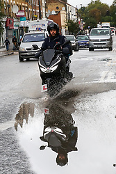 © Licensed to London News Pictures. 25/09/2019. London, UK. A motorbike rider drives through a large puddle of rainwater on Green Lanes in north London following heavy downpour early this morning. Photo credit: Dinendra Haria/LNP Photo credit: Dinendra Haria/LNP