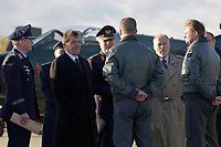 03 NOV 2003, LAAGE/GERMANY:<br /> Gerhard Schroeder (L), SPD, Bundeskanzler, und Gerhard Back (M), Inspekteur der Luftwaffe, und Harald Ringstorff (R), SPD, Ministerpraesident Mecklenburg-Vorpommern, im Gespraech mit Piloten der Bundesluftwaffe, waehrend dem Besuch der Luftwaffe, Fliegerhorst Laage<br /> IMAGE: 20031103-01-033<br /> KEYWORDS: Bundeswehr, Bundesluftwaffe, Gerhard Schröder