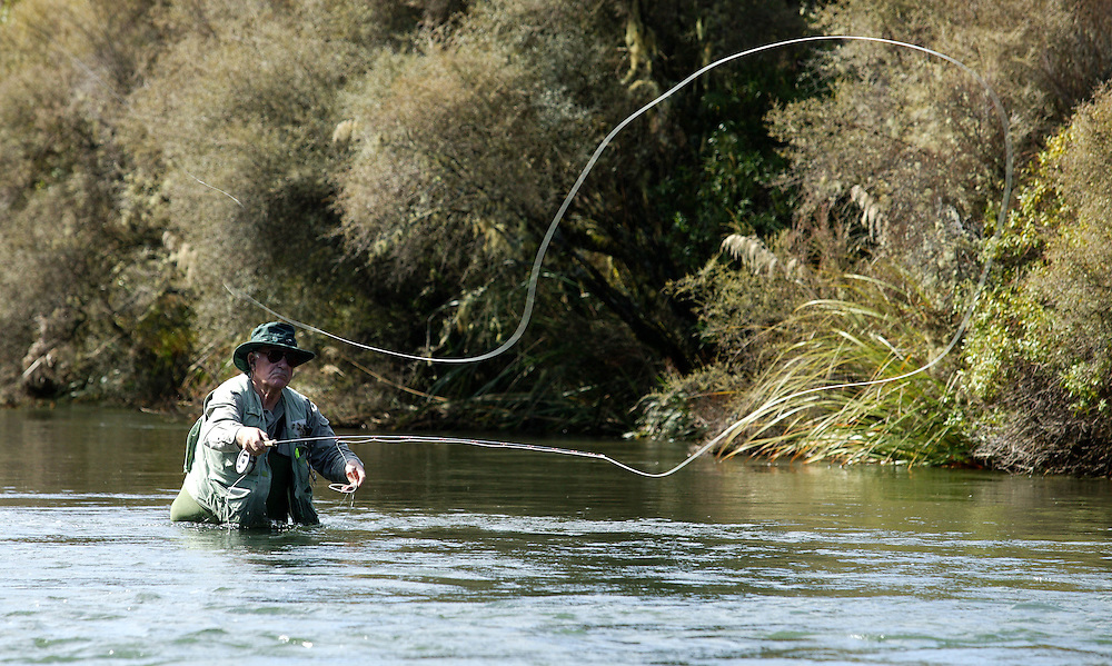 Taupo trout fisherman, Brian Wrathwall, casting up stream during a trout fishing experdition in the Kaingaroa Forest in the Central North Island, New Zealand. Credit:SNPA / Rob Tucker