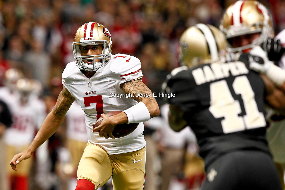 November 25, 2012; New Orleans, LA, USA; San Francisco 49ers quarterback Colin Kaepernick (7) runs for a touchdown against the New Orleans Saints during the first quarter of a game at the Mercedes-Benz Superdome. Mandatory Credit: Derick E. Hingle-US PRESSWIRE