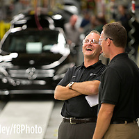 Bob Farley/F8Photo.org --Mercedes-Benz C-Class CEO Jason Hoff talks with Group Leader Jamie Maddox.