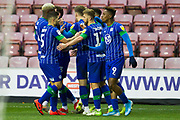 Wigan celebrate Josh Windass scoring a goal during the EFL Sky Bet Championship match between Wigan Athletic and Huddersfield Town at the DW Stadium, Wigan, England on 14 December 2019.
