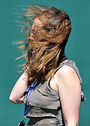 © licensed to London News Pictures. EPSOM, UK.  03/06/11.Wind at Epsom Derby Ladies Day. Sunshine and wind made for a busy Ladies Day today, 3rd June 2011.  Photo credit should read Stephen Simpson/LNP