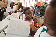Ghana: 25 April 2012, Priscilla Boni, 33, listens to a nurse as she sits with her son Desmond Ohene Akonor, 18 months old, who suffers from broncho-pneumonia, at the Princess Marie Louise Children's hospital in Accra. The GAVI Alliance is a public-private partnership that brings together developing country and donor governments, WHO, UNICEF, the World Bank, the vaccine industry in both industrialised and developing countries, research and technical agencies, civil society, the Bill & Melinda Gates Foundation and other private philanthropists.  Set up in 2000 as the Global Alliance for Vaccines and Immunisation, GAVI's mission is to save children's lives and protect people's health by increasing access to immunisation in the world's poorest countries.