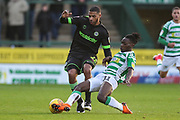 Yeovil Towns Jordan Green(11) tackles Forest Green Rovers Reuben Reid(26) during the EFL Sky Bet League 2 match between Yeovil Town and Forest Green Rovers at Huish Park, Yeovil, England on 8 December 2018.