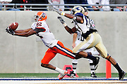 Sept. 4, 2010; Akron, OH, USA; Syracuse Orange wide receiver Van Chew (82) catches a touchdown pass under pressure from Akron Zips safety Josh Richmond (33) during at the end of the second quarter at InfoCision Stadium. Mandatory Credit: Jason Miller-US PRESSWIRE