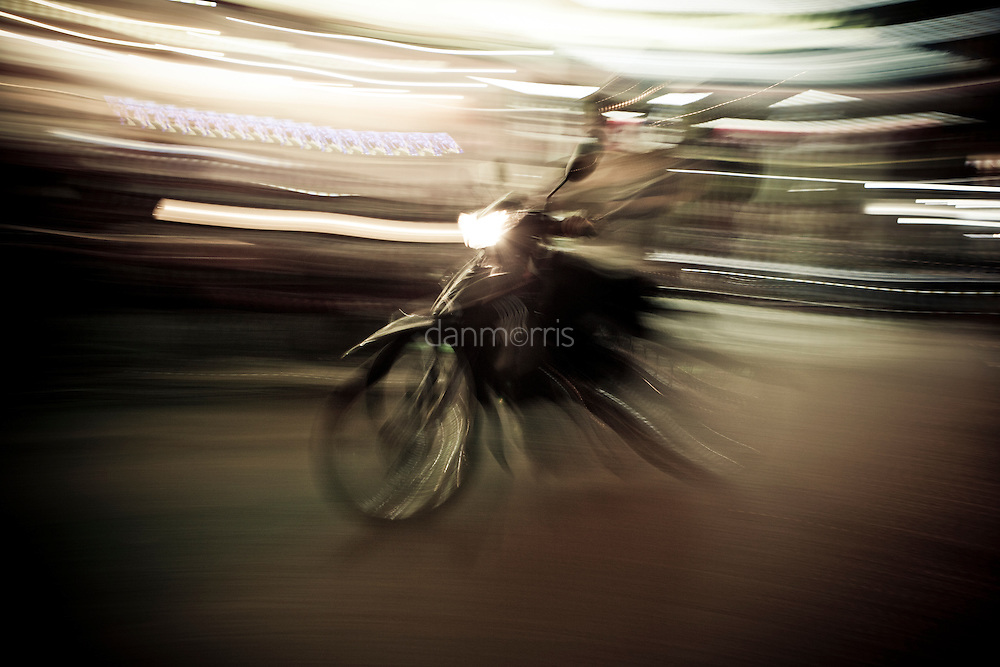 Scooter driving at night, French Quarter, Hanoi, Vietnam