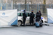 Brussels 23 March 2016 police at the perimeter responding to questions of tourists with suitcases, disoriented in Brussels, where the public transport doesn't run yet.