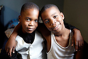 "Bothers Mohammed Kone,7, and Abraham,9 find comfort in the love they share with each other. The two go to school at a private Christian boarding school in Binghampton. The school allows students to live on campus, in order to be given the opportunity for a more successful educational experience. Fifteen years ago, ""God placed a burden on the heart "" of Mrs. Jo Walt, for the hurting children in our community. Her answer, was to open The Neighborhood School. They are originally from the Ivory Coast."