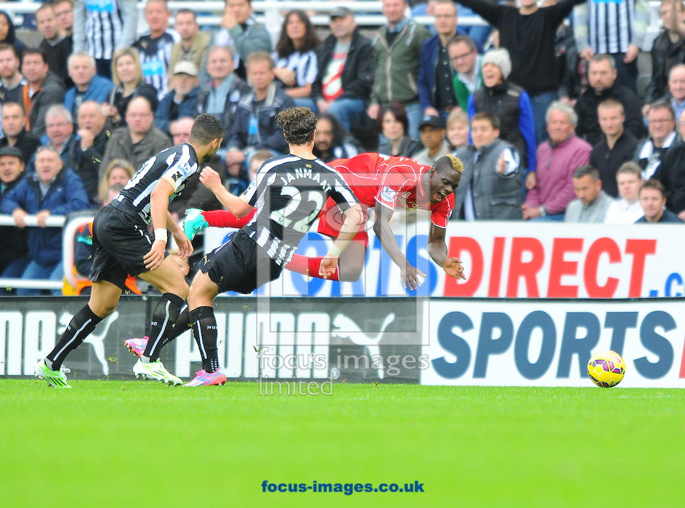 Daryl Janmaat of Newcastle United (number 22) tackles Mario Balotelli of Liverpool (right) during the Barclays Premier League match at St. James's Park, Newcastle<br /> Picture by Greg Kwasnik/Focus Images Ltd +44 7902 021456<br /> 01/11/2014