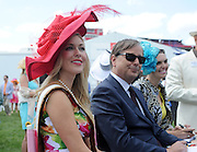 Ms Racing Queen Linsey Toole, Charles Villoz, of Longines, and Brianna Mott, judge Longines Most Elegant Woman at the Preakness contest, Saturday, May 17, 2014, in Baltimore, MD. Longines, the Swiss watch manufacturer known for its luxury timepieces, is the Official Watch and Timekeeper of the 139th annual Preakness Stakes and Triple Crown.  (Diane Bondareff/Invision for Longines)