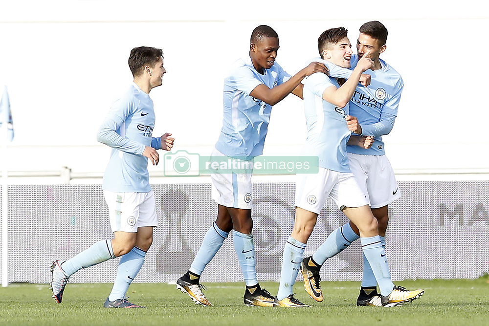 Manchester City's Benjamin Garre (right) celebrates scoring his side's second goal of the game