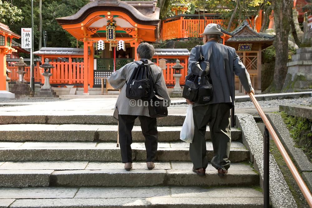 elderly couple walking up the stairs Japan Kyoto Fushimi Inari Taisha Shrine