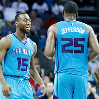 01 November 2015: Charlotte Hornets guard Kemba Walker (15) reacts next to Charlotte Hornets center Al Jefferson (25) during the Atlanta Hawks 94-92 victory over the Charlotte Hornets, at the Time Warner Cable Arena, in Charlotte, North Carolina, USA.