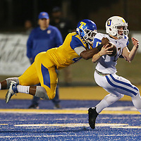 Tupelo's Ladarrius Sanders reaches to tackle Oxford quarterback John Meagher during Friday night's game against Oxford.