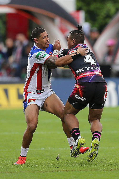 Dane Gagai of the Newcastle Knights challenges Solomone Kata of the New Zealand Warriors during their round 12 NRL match at Mount Smart Stadium, Auckland on  Sunday, May 31, 2015. Credit: SNPA / David Rowland