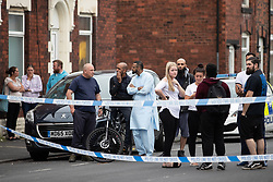 © Licensed to London News Pictures . 13/06/2018. Manchester , UK. Scene on Birch Street , Ashton-Under-Lyne where a man was critically hurt in a shooting , this afternoon . Photo credit : Joel Goodman/LNP