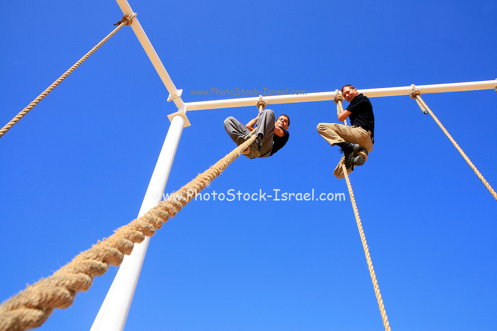 Israel military training camp. Physical Fitness training . Rope climbing
