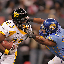 2008 November, 29: Grambling State running back Frank Warren (23) runs as he is grabbed by Southern University linebacker Gary Chatman (39) during the first half of the 35th annual State Farm Bayou Classic between Southern University and Grambling State University at the Louisiana Superdome in New Orleans, LA.  .