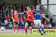 Morecambe Midfielder Andrew Flemming and Carlisle United Jason Kennedy battle during the EFL Sky Bet League 2 match between Morecambe and Carlisle United at the Globe Arena, Morecambe, England on 8 October 2016. Photo by Pete Burns.