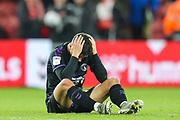 Charlton Athletic midfielder Albie Morgan (19) sits on the floor with his head in his hands following the EFL Sky Bet Championship match between Middlesbrough and Charlton Athletic at the Riverside Stadium, Middlesbrough, England on 7 December 2019.
