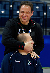 Sokol Kadrija relaxes Gorazd Skof of Slovenia during practice session of Slovenia national team 1 day before handball match against Macedonia for 5th place at 10th EHF European Handball Championship Serbia 2012, on January 26, 2012 in Beogradska Arena, Belgrade, Serbia.  (Photo By Vid Ponikvar / Sportida.com)