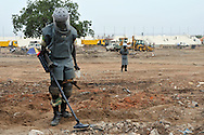 Two SPLA deminers clear a huge number of unexploded ordinance found scattered across a large, open terrain just opposite John Garang's tomb in Juba as the area was being prepared for South Sudan independence ceremonies. The Government of South Sudan called on Mines Advisory Group (MAG) to assist SPLA deminers in an attempt to clear the area and make it safe for the thousands of people and dignitaries who will be attending the declaration of independence on July 9th...Juba, South Sudan. 04/07/2011..Photo © J.B. Russell