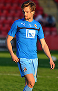 Harrison Dunk warms up during the Sky Bet League 2 match between Cheltenham Town and Cambridge United at Whaddon Road, Cheltenham, England on 14 April 2015. Photo by Alan Franklin.