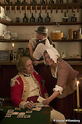 Spy story shot for CWJ:  Bill Rose as Bartender Robin Reed as Redcoat Carrie MacDougal as barmaid at the Raleigh Tavern bar