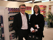 Frank and Cheryl Cohen, Patrons dinner pre -drinks in the shopping exhibition, Tate Liverpool, 20 February 2003. © Copyright Photograph by Dafydd Jones 66 Stockwell Park Rd. London SW9 0DA Tel 020 7733 0108 www.dafjones.com