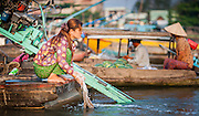 Woman doing laundry in Mekong River