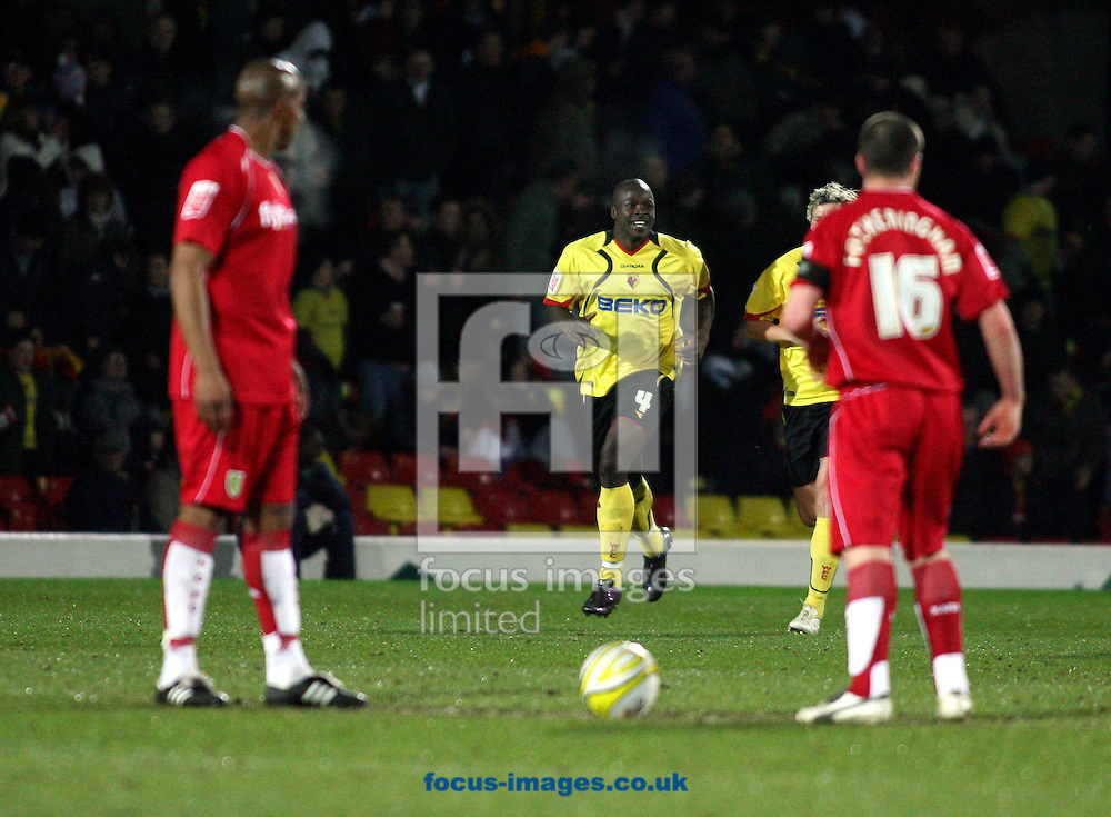 London - Tuesday, March 4th, 2008: Daniel Shittu of Watford celebrates his goal as Norwich City players watchon during the Coca Cola Champrionship match at Vicarage Road, London. (Pic by Chris Ratcliffe/Focus Images)