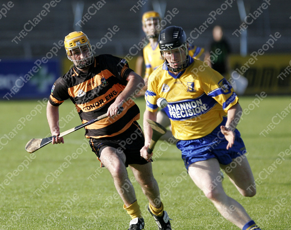 Niall Gilligan keeps his eye on the ball as Matt Fitzsimons keeps his eye on Gilligan as Tubber and Sixmilebridge met in Cusack Park on Friday.<br />