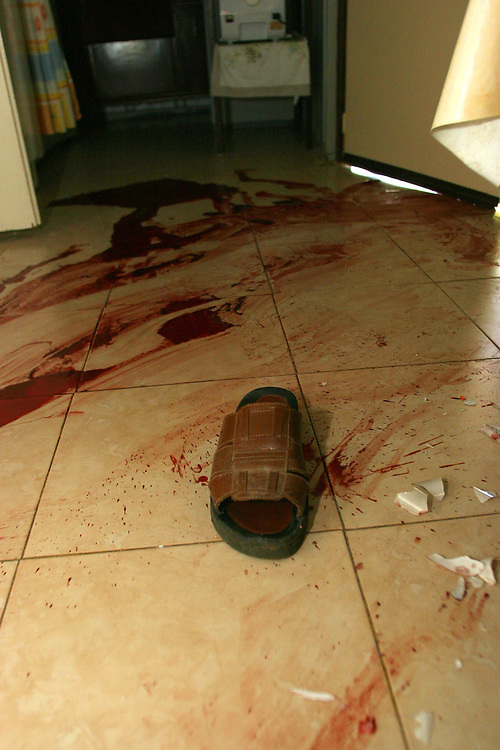 A stain of blood is seen on the floor at a house that was hit during a Hezbollah rocket attack in the town of Yaara, northern Israel, Sunday, Aug. 13, 2006.