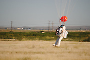 """Watch Google exec Alan Eustace break freefall record with 135,000 foot jump from outer space <br /> <br /> He broke the sound barrier and hit a top speed of 822mph during his four-and-a-half minute descent to Earth    <br /> This is the moment a Google executive broke the sound barrier and set a new freefall record with a 135,000 foot jump from space.<br /> <br /> Wearing a specially-designed spacesuit which took three years to develop, Alan Eustace made his ascent via a high-altitude, helium-filled balloon just as the sun was rising.<br /> <br /> He then separated himself from the balloon and started to plummet back to Earth.<br /> <br /> Eustace - who smashed the record previously held by daredevil Felix Baumgartner - hit a top velocity of 822mph during a freefall that lasted four and a half minutes before landing in the southern New Mexico desert.<br /> <br /> Jim Hayhurst, director of competition at the United States Parachute Association, the jump's official observer, said Eustace used a drogue parachute that gave him incredible stability and control despite the massive Mach 1.23 speed reached during the freefall.<br /> <br /> Mr Eustace - who has 25 years experience as a pilot - said he did not feel it when he broke the sound barrier, but the ground crew heard the resulting sonic boom.<br /> <br /> """"He just said it was a fabulous view. He was thrilled,"""" said Mr Hayhurst of his conversation with Eustace after he landed.<br /> <br /> The supersonic jump was part of a project by Paragon Space Development and its Stratospheric Explorer team, which has been working secretly for years to develop a self-contained commercial spacesuit that would allow people to explore about 20 miles above the Earth's surface.<br /> <br /> Mr Eustace's success marks a major step forward.<br /> <br /> """"This has opened up endless possibilities for humans to explore previously seldom visited parts of our stratosphere,"""" said Grant Anderson, Paragon's president and CEO.<br /> <br /> The te"""