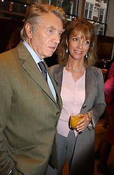 Photographer DON McCULLIN and SABRINA GUINNESS at a party to celebrate the publication of 'Last Voyage of The Valentina' by Santa Montefiore at Asprey, 169 New Bond Street, London W1 on 12th April 2005.<br /><br />NON EXCLUSIVE - WORLD RIGHTS