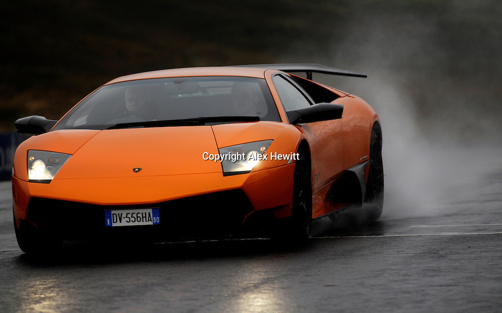Scotsman Journalist Peter Ranscombe puts the Lamborghini Gallardo LP 550 Valentino Balboni (black) and the Lamborghini Murcielago LP 670 4SV (orange) through their paces at Knockhill Race Circuit in Fife, Scotland..Pic by Alex Hewitt