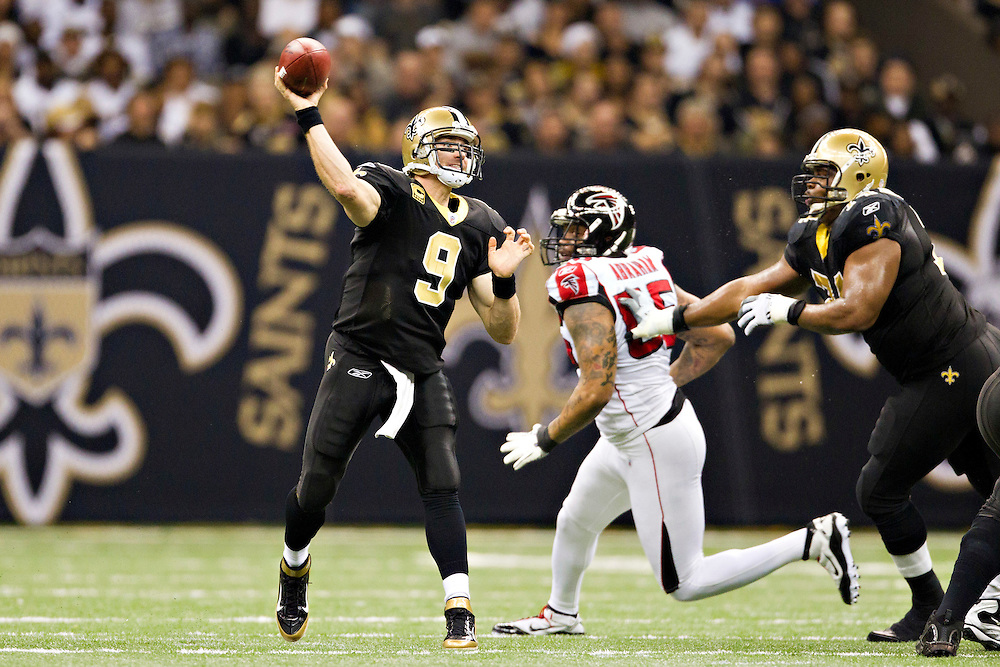 NEW ORLEANS, LA - DECEMBER 26:   Drew Brees #9 of the New Orleans Saints throws a pass against the Atlanta Falcons at Mercedes-Benz Superdome on December 26, 2011 in New Orleans, Louisiana.  The Saints defeated the Falcons 45-16.  (Photo by Wesley Hitt/Getty Images) *** Local Caption *** Drew Brees