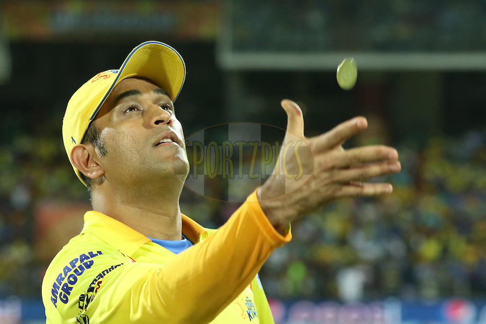 CSK captain Dhoni flipping the coin at toss during match 43 of the Pepsi IPL 2015 (Indian Premier League) between The Chennai Superkings and The Mumbai Indians held at the M. A. Chidambaram Stadium, Chennai Stadium in Chennai, India on the 8th May April 2015.<br /> <br /> Photo by:  Saikat Das / SPORTZPICS / IPL