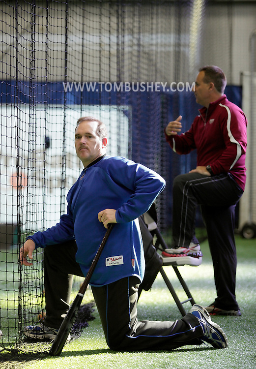 Chester, New York - Former New York Mets baseball star player Howard Johnson watches a young player hit the ball at the first anniversary open house celebration at The Rock Sports Park on Nov. 12, 2011. Frozen Ropes founder and instructional director Tony Abbatine is in the background.