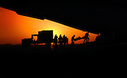 U.S. Air Force Airmen transfer wounded military personnel from an ambulance to a C-17 Globemaster III aircraft in Baghdad, Iraq, on June 22, 2003.