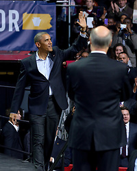 Philadelphia, PA, USA - November 2, 2014: U.S President Barrack Obama enters the arena where he joins gubernatorial candidate Tom Wolf in his race for seat of Governor of Pennsylvania in the November 4, 2014 elections. (Photo by Bas Slabbers)<br /> <br /> U.S. President Barrack Obama headlines the Grassroots event in support of PA Gubernatorial Democratic candidate Tom Wolf. Wolf is running against Incumbent Governor of Pennsylvania Tom Corbett (R). The event is held at Liacouras Center at Temple University in North Philadelphia two days ahead of election day.<br /> <br /> Get an editorial licensing for this image at iStock: http://www.istockphoto.com/photo/obama-headlines-tom-wolf-rally-in-philadelphia-50922522